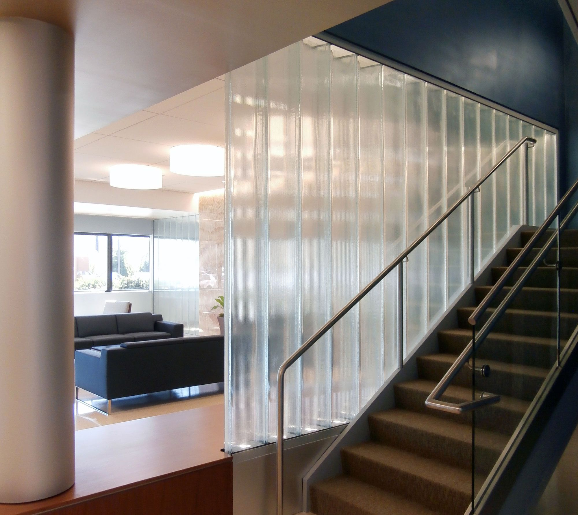 Walls Made Of Double Glazed Channel Glass From Bendheim Wall Systems Are Featured In The Main Lobby Of This Comme Wall Systems Channel Glass Glass Wall Systems