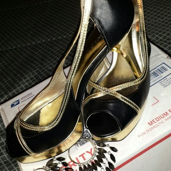 Black/Gold peep toes 4.5 in heels worn twice Wild Diva  peep toes fits like a 9 Wild Diva Shoes Heels
