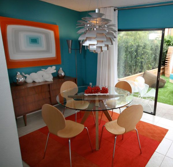 Orange and teal dining room designed by david bromstad for Teal dining room decorating ideas
