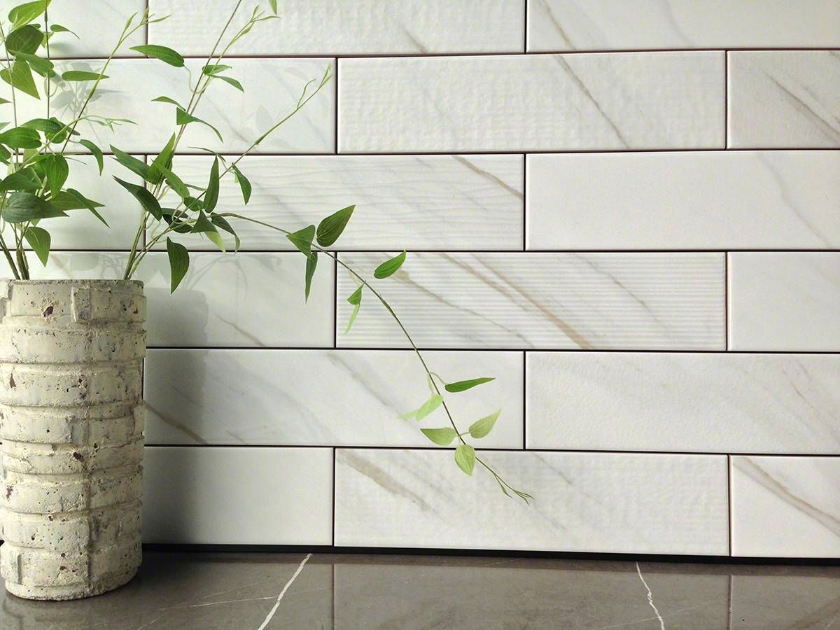 Classique white calacatta subway tile is a tough ceramic mosaic classique white calacatta subway tile is a textured ceramic marble look mosaic ideal for backsplashes feature walls and other vertical surfaces dailygadgetfo Images