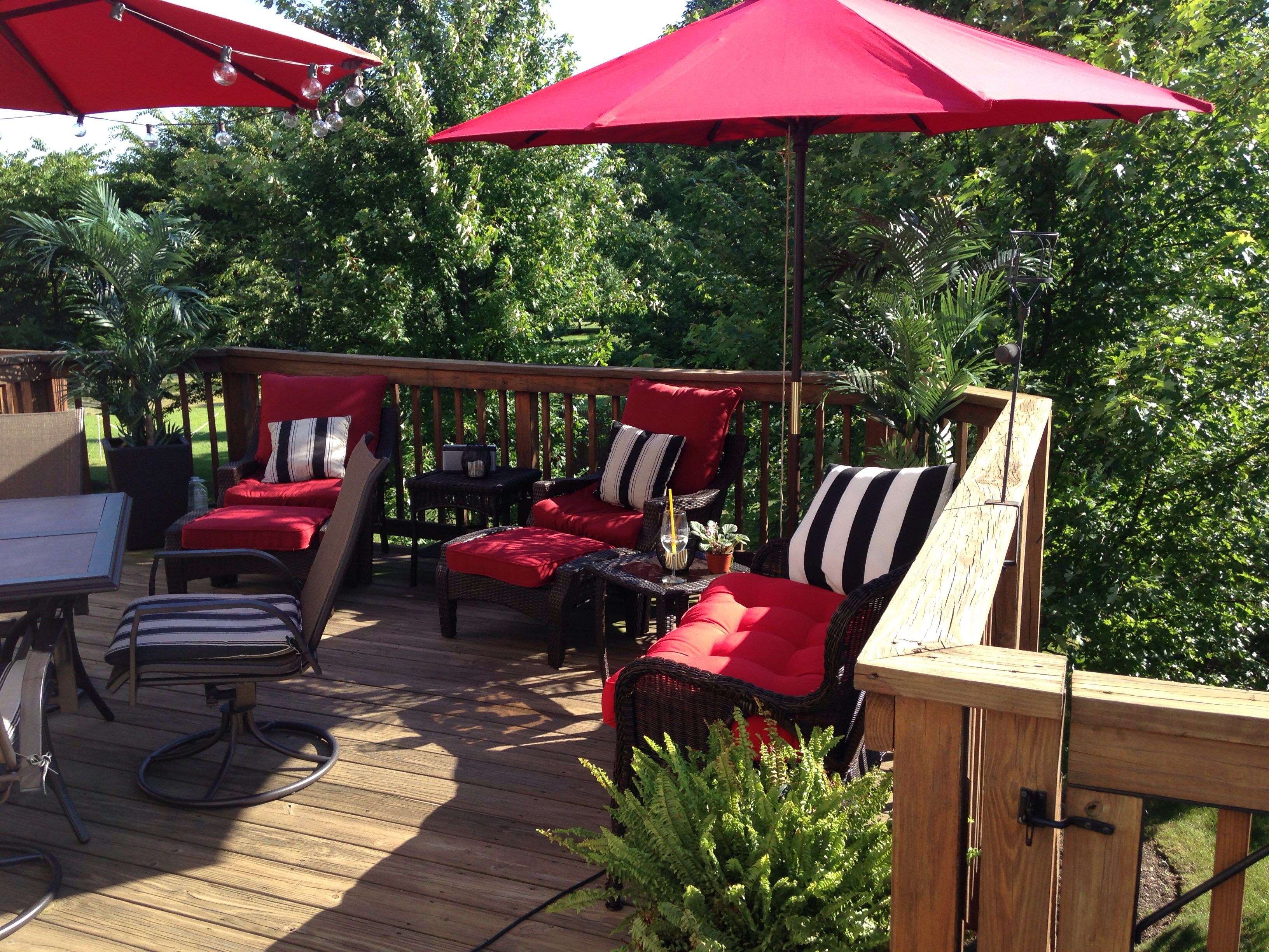 Red patio furniture cushions with black and white striped ...