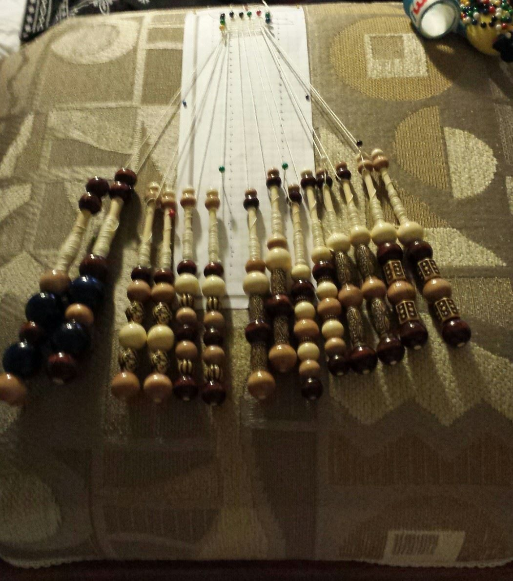 bobbins made by pinner, bobbin lace pillow by her mother in law