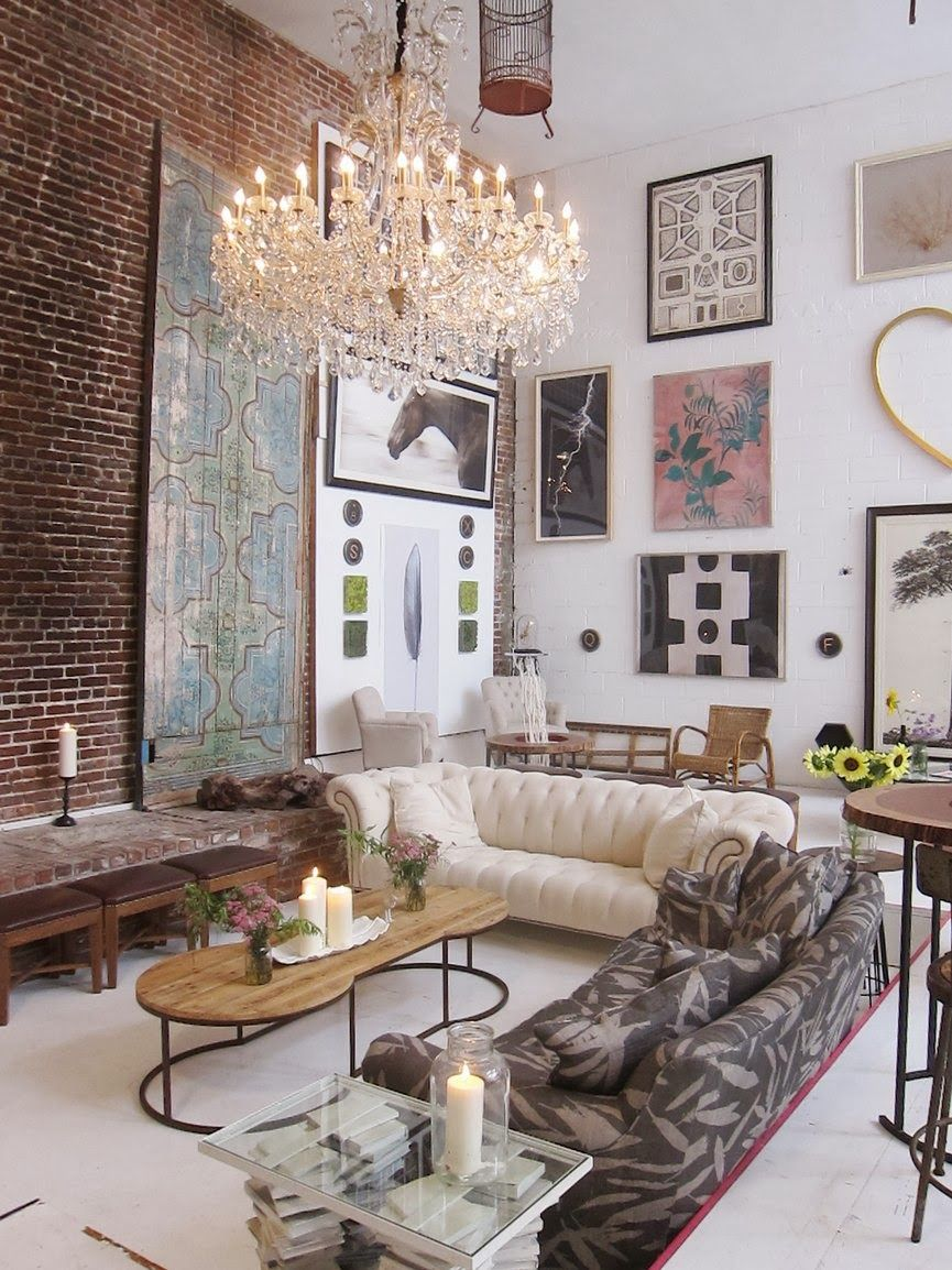 Living Room W Gorgeous Chandelier Dramatic High Ceiling Exposed Brick Wall Great Mix Of Decor
