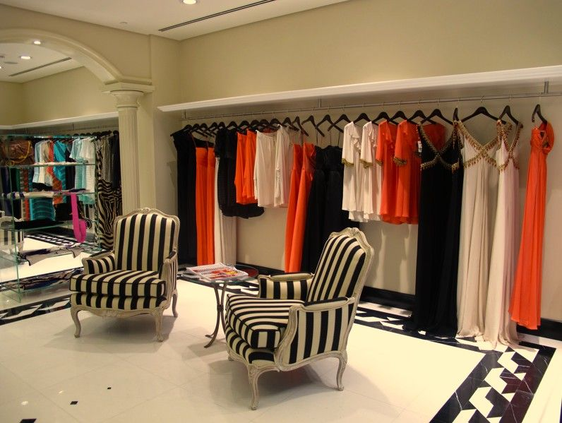 Mititique boutique fashion boutique interior with modern for Interior designs of boutique shops