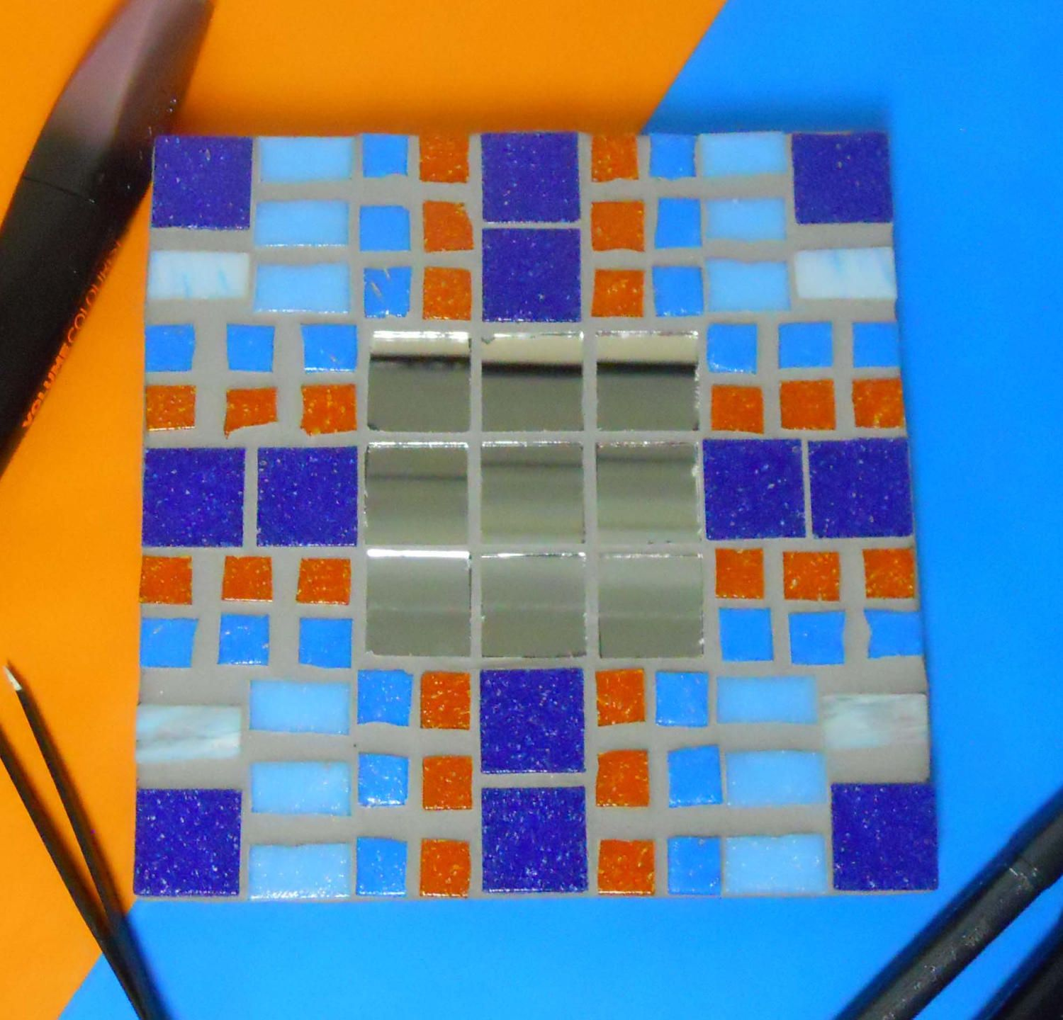 Blue and orange made up glass mosaic mirror by