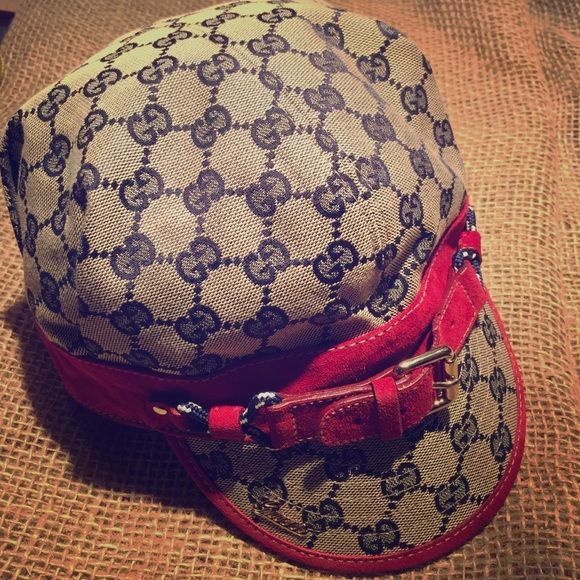 """Gucci hat Gucci hat short brimmed with navy blue Gucci logo canvas trimmed in red suede and gold metal accents. Size says large and just measured the circumference as best as I could and came up with approx 21.5"""" which is standard size for hats. Great condition, small dark area in the back, if interested I will try and clean, worn twice with a super cute outfit! Sorry no trades! Gucci Accessories Hats"""