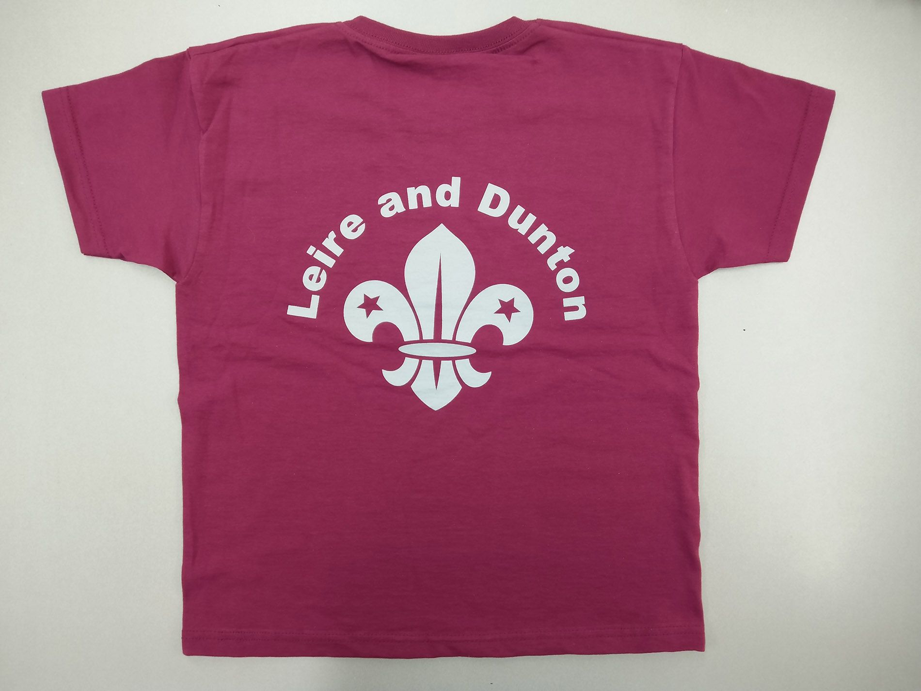 For the Leire and Dunton Scout Group – T-shirts printed with custom logo on the front and custom print on the back. Short sleeved t-shirts in Burgundy – Looking Great!