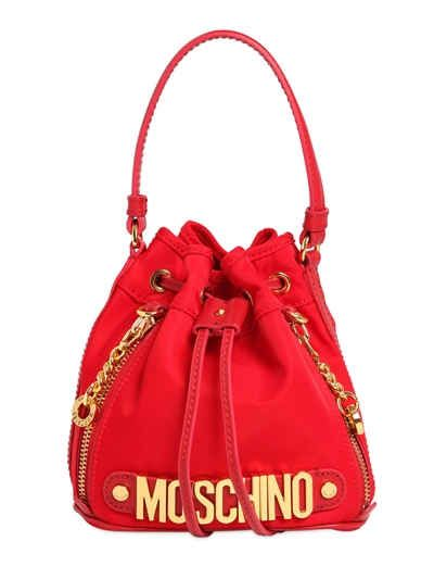 13690b8d22 MOSCHINO MINI LOGO LETTERING NYLON BUCKET BAG. #moschino #bags #leather  #lining #bucket #shoulder bags #hand bags #nylon #
