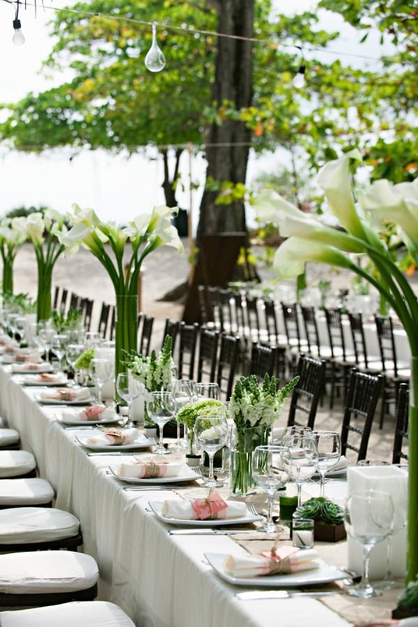 Emerald Green, White, and a touch of blush = beautiful long table reception seating and centerpieces - stylemepretty.com