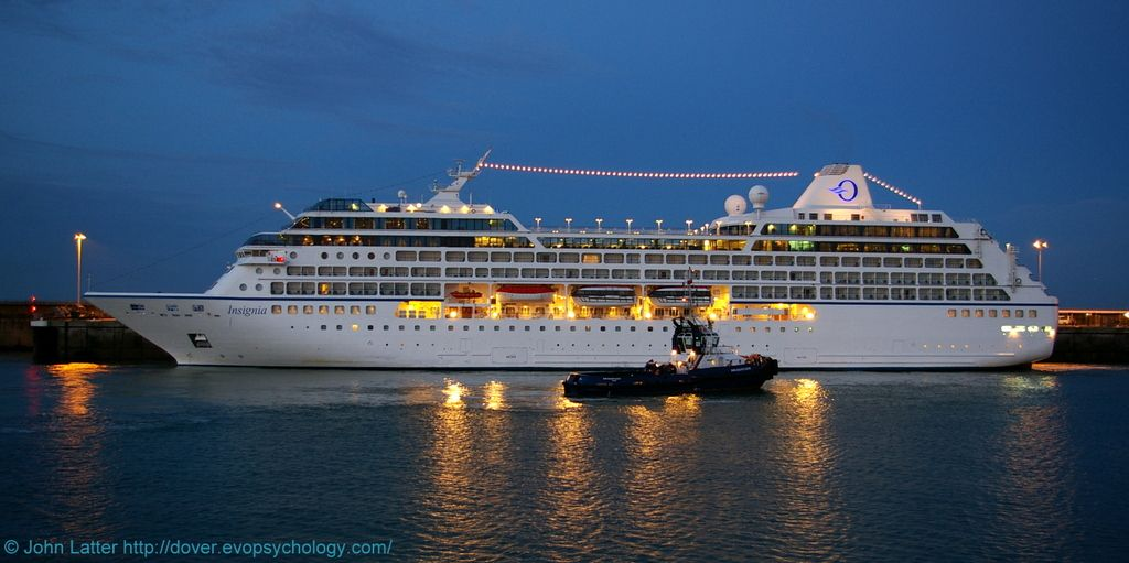 MS Insignia Cruise Ship at CT1 before Dawn, Admiralty Pier, Dover Harbour, Kent, England, UK. Owner: Oceania Cruises. Ex-R One, now MS Columbus 2: IMO 9156462, Callsign V7DM2, MMSI 538001663. En route Portland (Devon) to Oslo (Norway). Berthed at Cruise Terminal 1, Western Docks. Dover Harbour Board tug DHB Dauntless: Call Sign MZGC8, IMO 9190456, MMSI 232004784. View: Prince of Wales Pier. 2010 Port of Dover travel, tourism, and holiday photo. See: http://www.panoramio.com/photo/38569507
