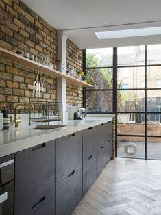 Long galley kitchen with herringbone wooden floor #whitegalleykitchens