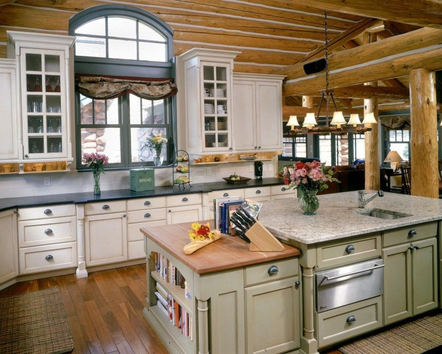 Rustic Theme Unifies This Kitchen Featuring Log Cabin Style Exposed Beams  And Columns, With Mixture