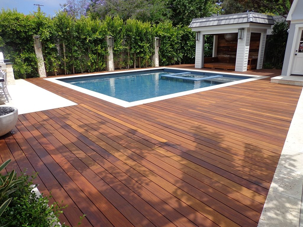 Contemporary Swimming pool with Fiberon composite decking