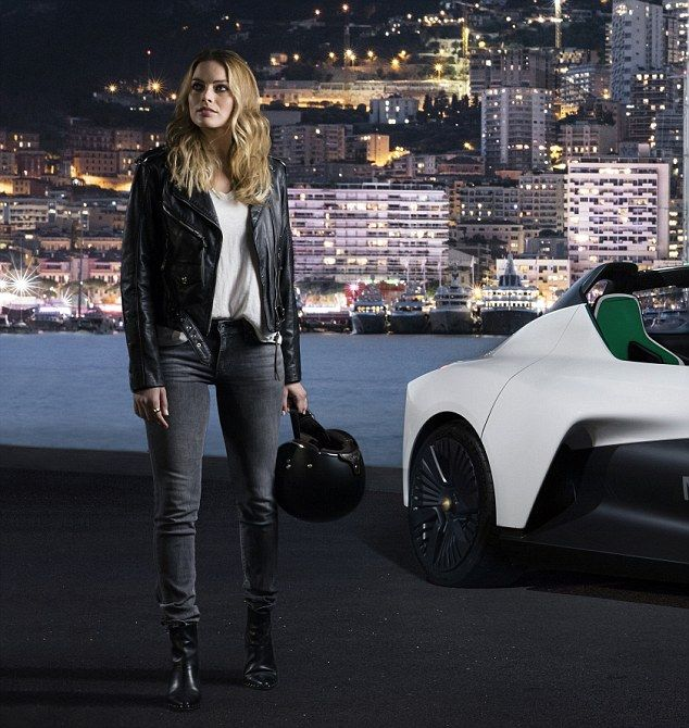Is there anything she can't do? Margot Robbie sets pulses racing as she takes on Grand Prix in new spokesperson role