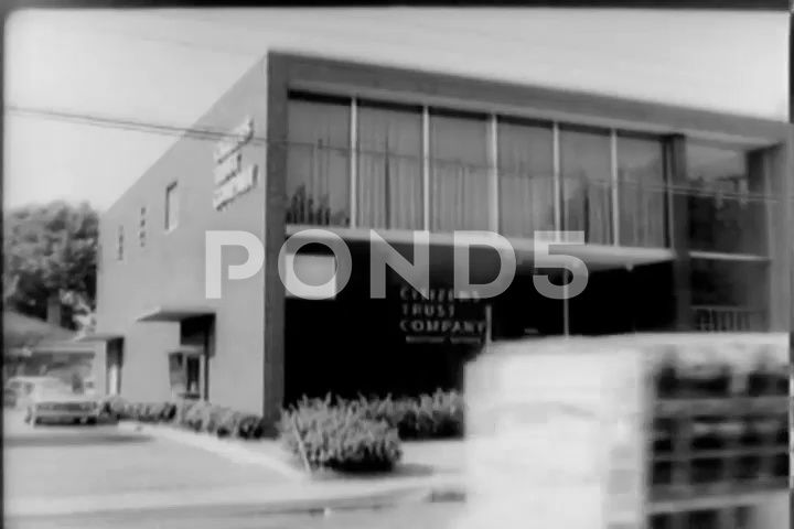 Scene of people entering Citizen Trust Company  1950 Stock Footage enteringCitizenScenepeople