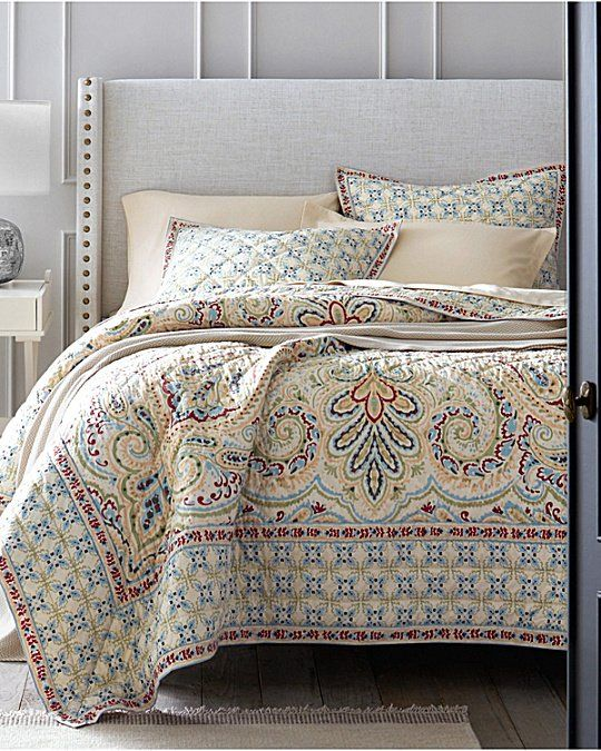 An elegant approach to the printed wholecloth quilt, this