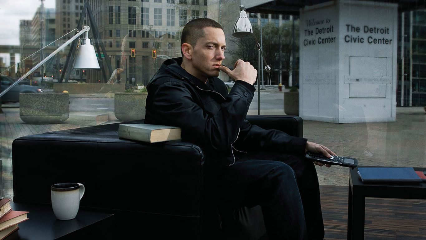 Hollywood Rapper Eminem Sitting On The Sofa Photo Picture