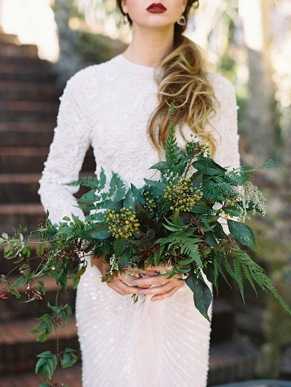 Skip the traditional wedding bouquet for a plush greenery. The bold arrangement will beautifully contrast with your white wedding gown.
