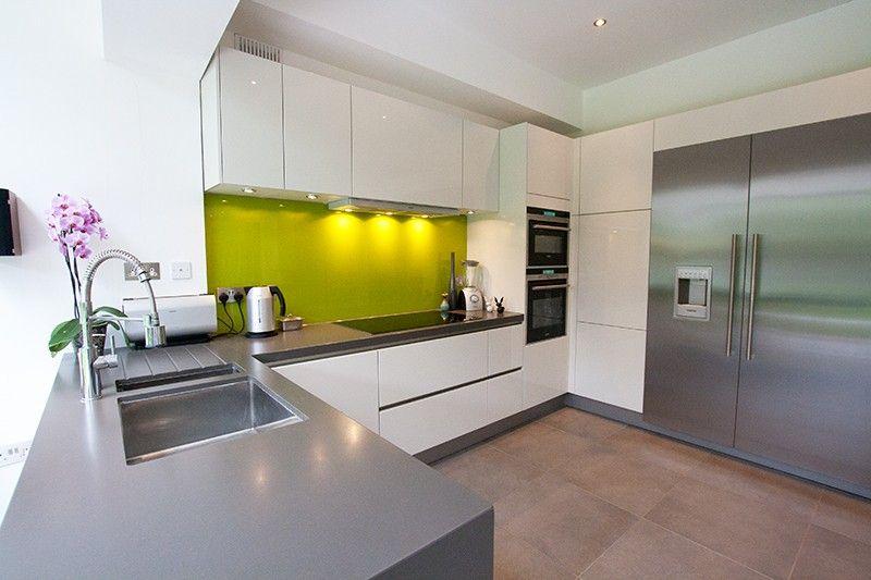 White Kitchen Grey Worktop handleless gloss white kitchen with zodiaq gravel grey 80mm