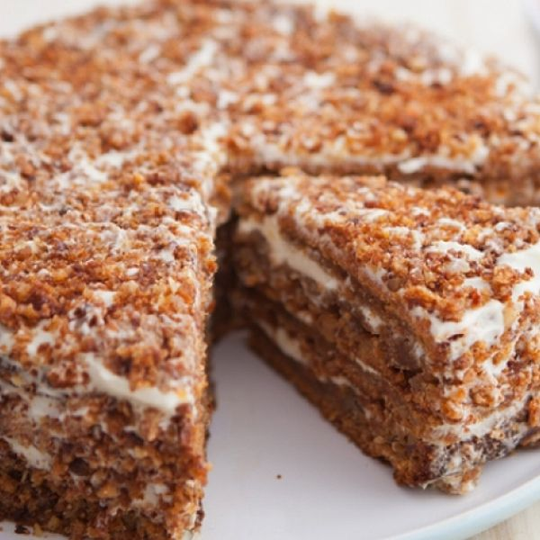 A Delicious Recipe For Honey Cake With Cream Fillings And