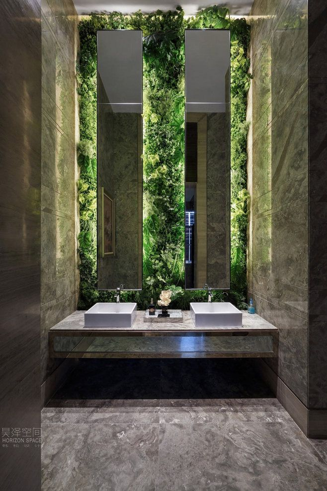 Illuminated live walls behind offset mirrors create a for Washroom ideas