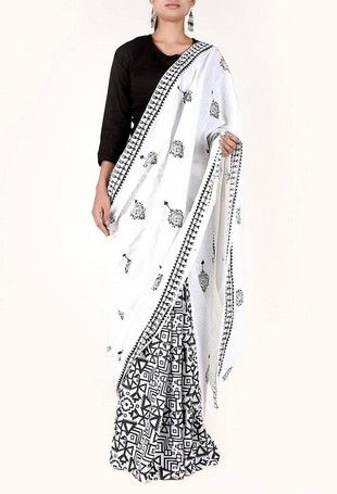 956bb1cd2e Crafted in contemporary pattern, this white and black saree is sure to add  a unique