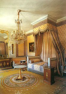 """Napoleon's chamber at Versailles.  The style corresponds to the Biedermeier style in the German-speaking lands, Federal style in the United States and to the Regency style in Britain. An earlier phase of the style was called the Adam style in Great Britain and """"Louis Seize"""" or Louis XVI, in France."""