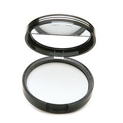 Laura Geller Matte Maker Invisible Oil Blotting Powder  Use for oily areas before you apply makeup.  Keeps the shine away all day!