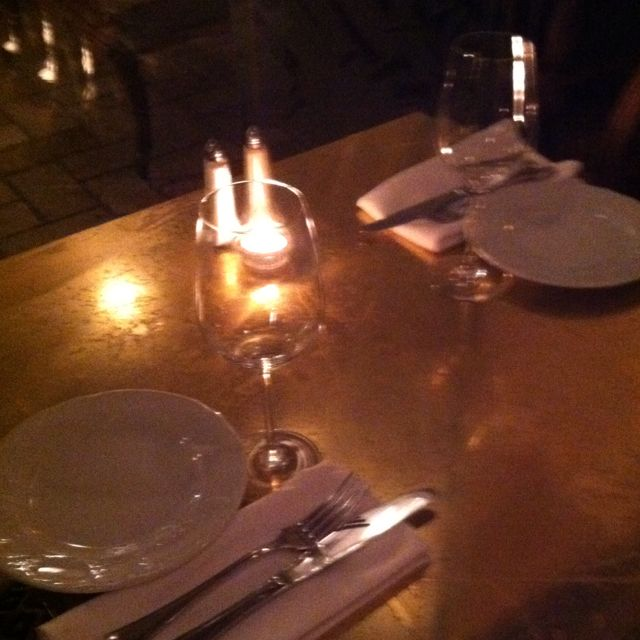 Copper-like table top at Dallal. Warm and luminous.