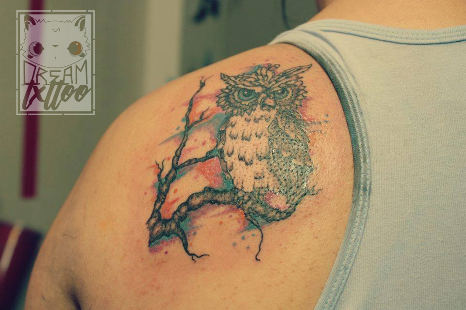 Watercolor Tattoo Of Blue Eyed Owl Standing On A Tree Branch Made