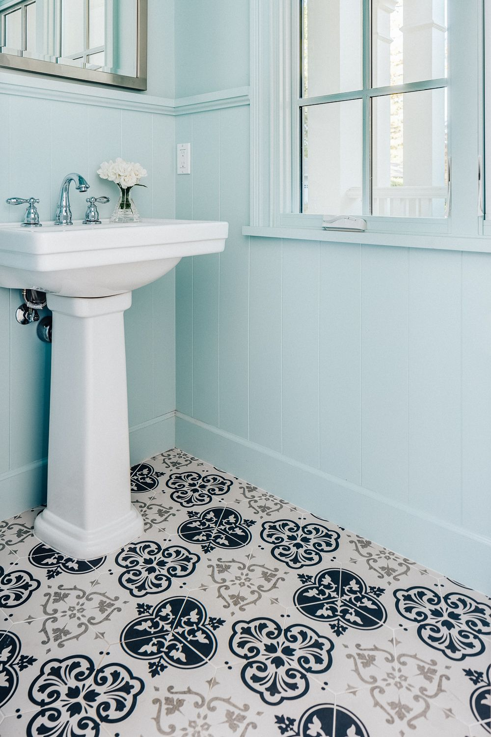 Beautiful patterned tile floor and pastel colored walls in this ...
