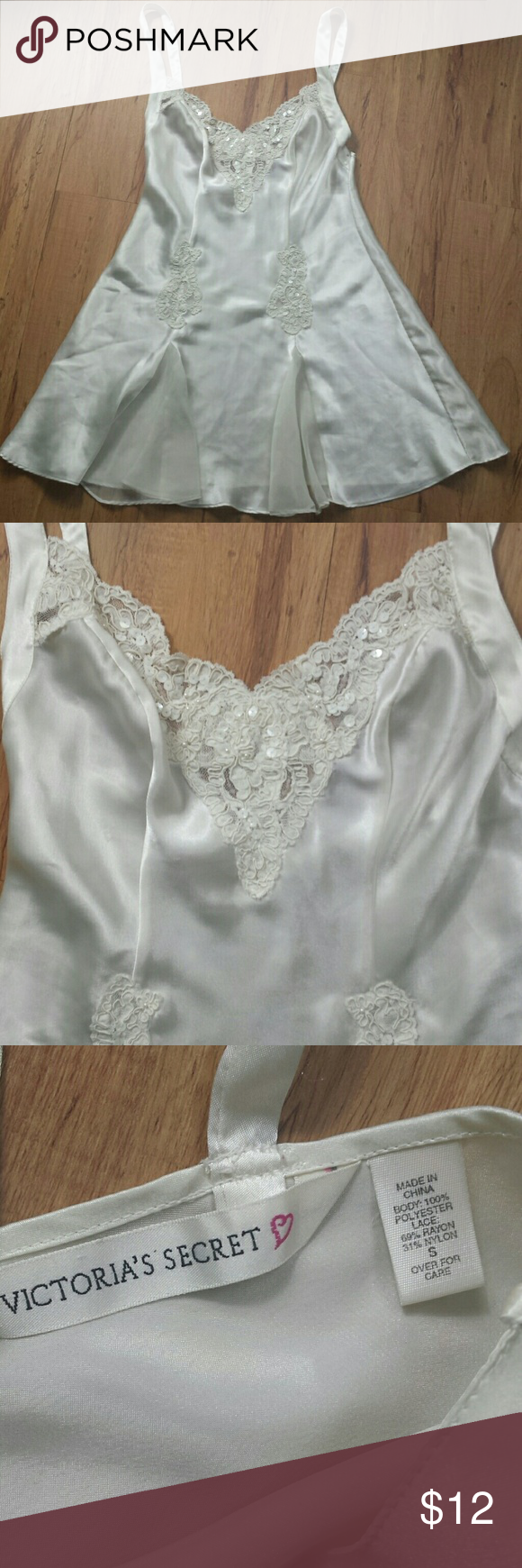 """VS Bridal Chemise Nightgown Lovely Victoria's Secret nightie is made of ivory polyester satin with beautiful lace and iridescent beads and spangle discs. It has 2 chiffon inserts at the bottom in front and has adjustable shoulder straps.  Across the chest measurement 17""""  Length 27""""  Good used condition Victoria's Secret Intimates & Sleepwear Chemises & Slips"""