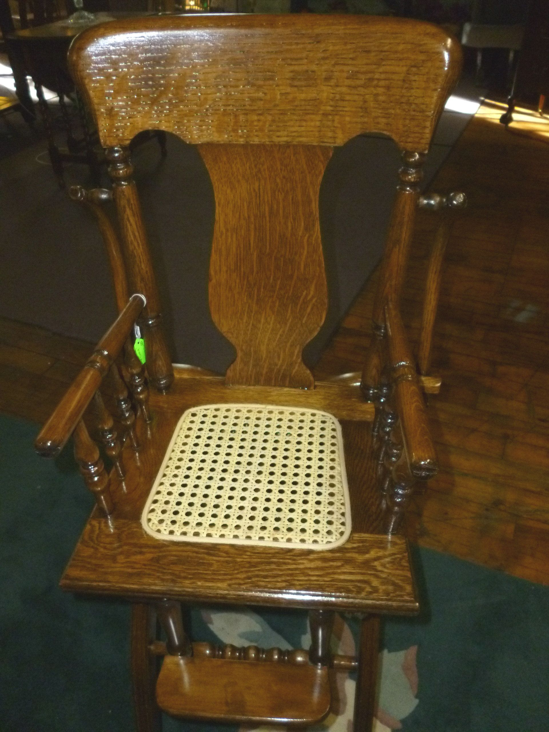 Antique High Chair Oak w/tray and cane seat. refinished