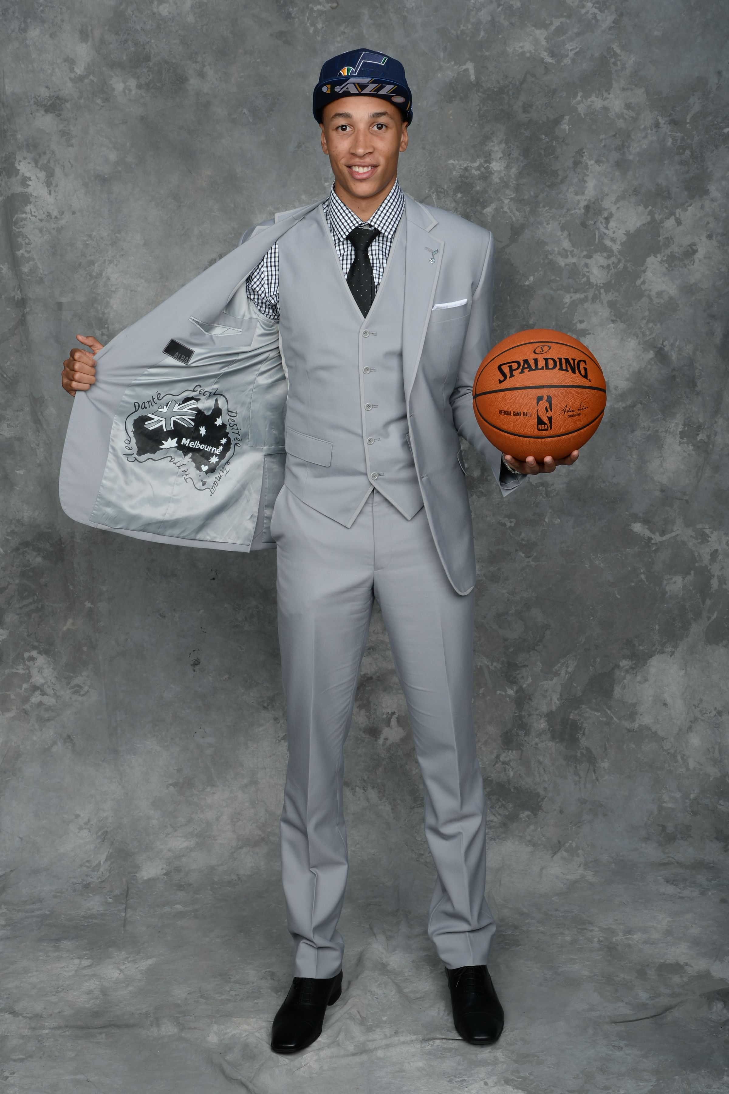 Dante Exum flashes the inside of his jacket showing off his native country of Australia