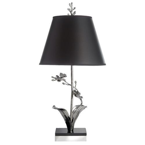 The michael aram white orchid table lamp is inspired by the beauty form and