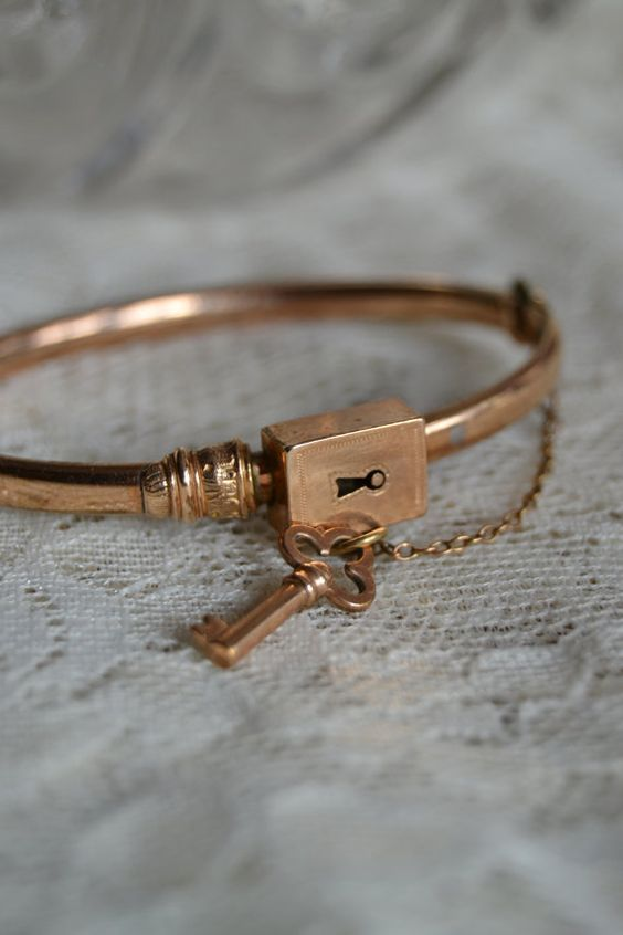 Beautiful And Unusual Victorian Bangle Bracelet With A Lock Key Design Circa 1880s
