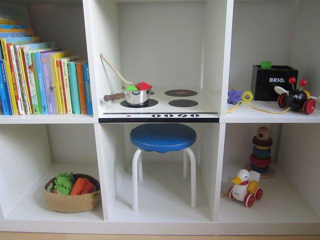Turn an IKEA bookshelf into a play kitchen.
