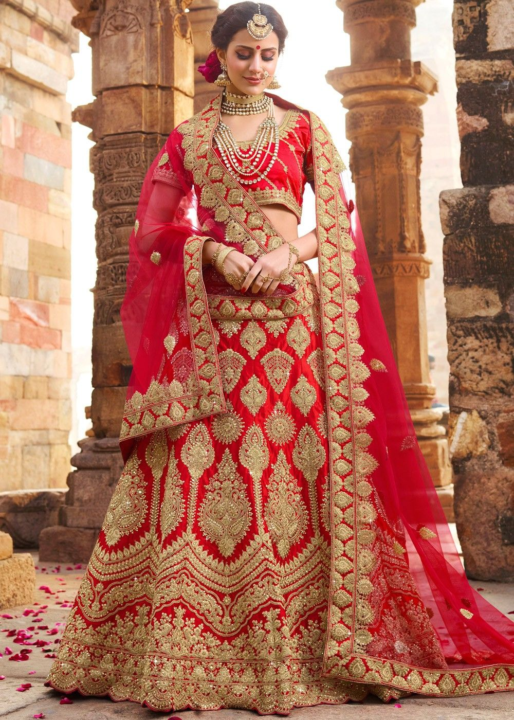 6ec527e5ea #Red A Line satin bridal #lehenga embellished with all over heavy  #embroidery and stone work.