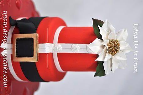 Santa For Her - Fondant finish with gumpaste poinsettia....Thanks for looking!..........Edna ;)