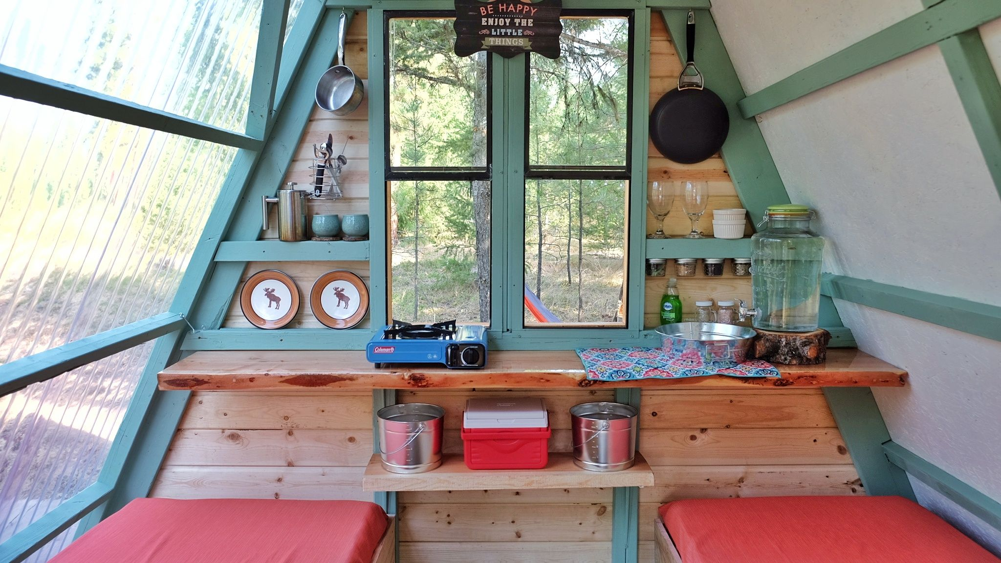Couple builds tiny A-frame cabin in three weeks for only $700 ...