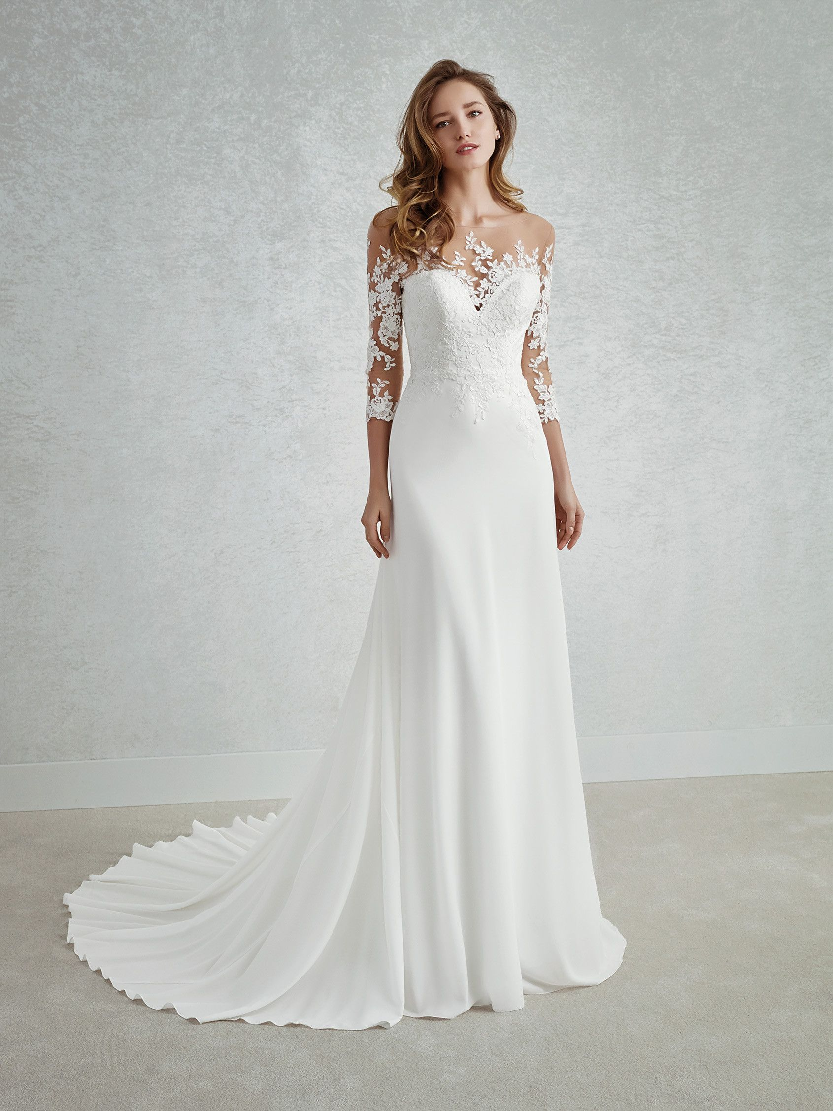b77c2909 This exquisite wedding dress combines a georgette skirt with a spectacular  bodice featuring an illusion neckline and back. As with the bodice, ...