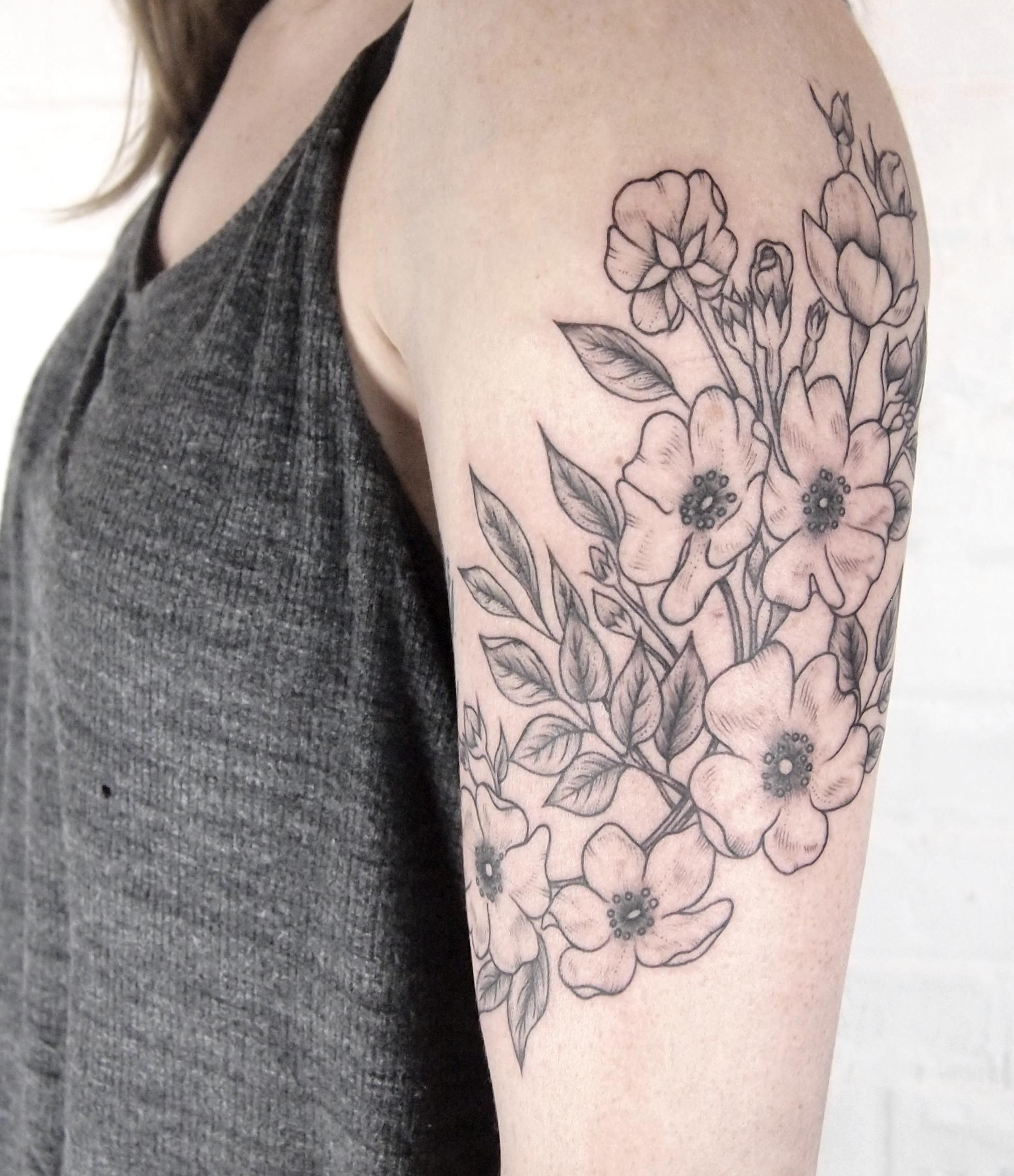Wild roses wrapping around arm tattoo people toronto for Tattoo around arm