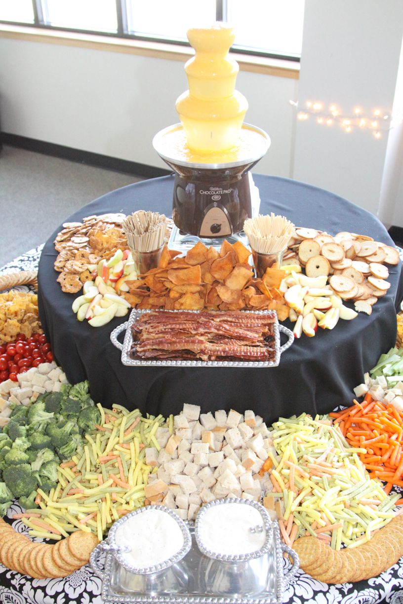Cheese Fountain With Lots Of Dipping Items Chocolate Fountain
