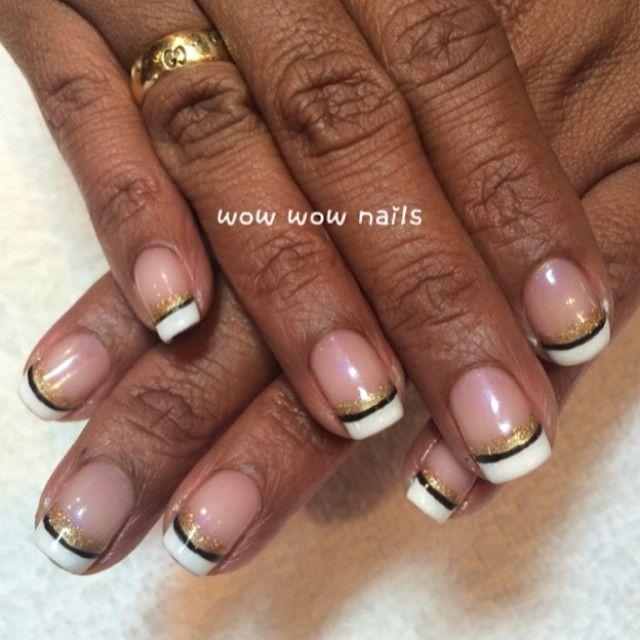 Rachelle's nail design! #holidaynails #happynewyear #nails #nailart #nailgasm #nailporn #naildesign #nailtrend #nailjunkie #frenchtips #frenchnails #glitter #glitternails #stripes #wowwownails #toronto