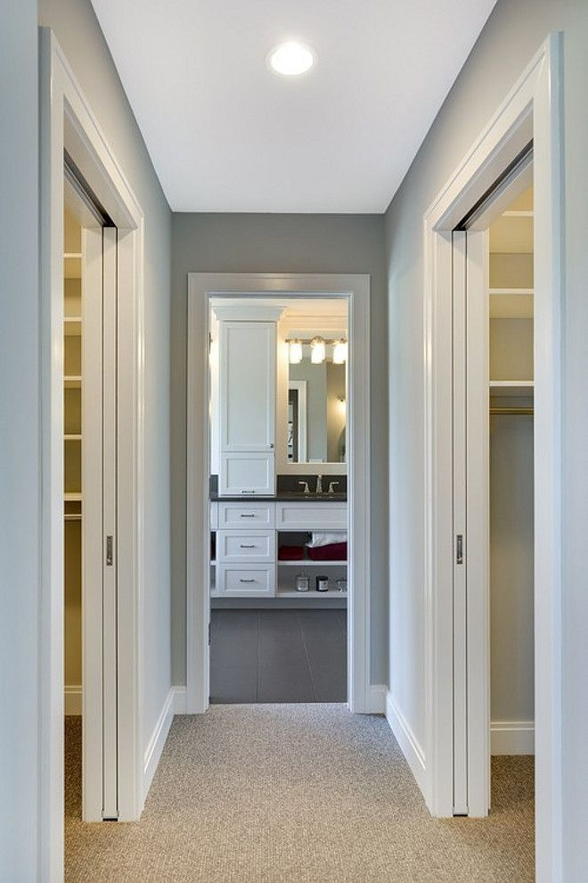 Separate his and her closets are located on either side of for Closet bathroom suites