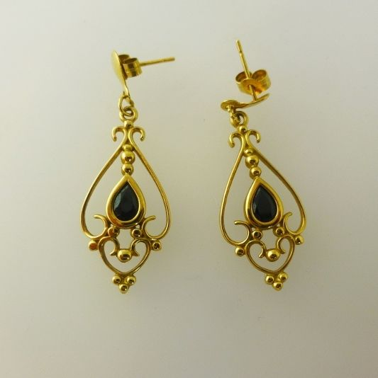 Sapphire Drop Earrings  £65    A lovely pair of earrings. Each earring features a tear shape sapphire set in gold and surrounded by fantastic ornate scroll work.