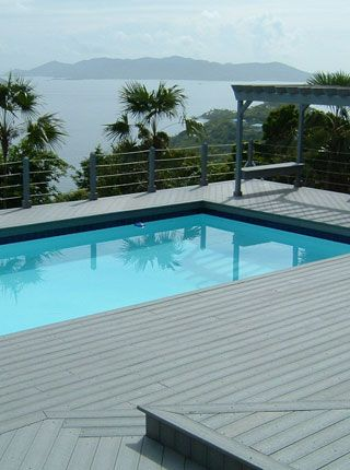 Composite decking around a nice pool awesome pool decks for How to deck around a pool