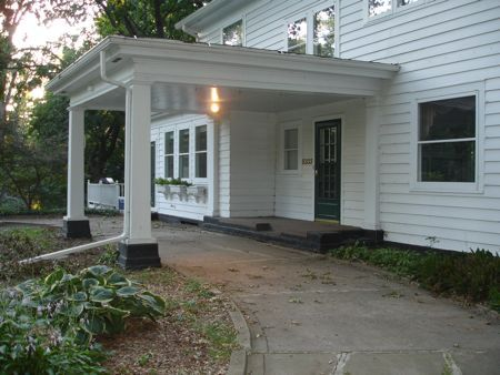 I'm thinking we will build a porte cochere to the right of the side porch, since we won't have a garage, for a bit of protection for our cars. #sideporch