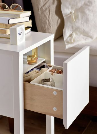 Tiny Nightstand close-up of small ikea bedside table, drawer open to reveal inside
