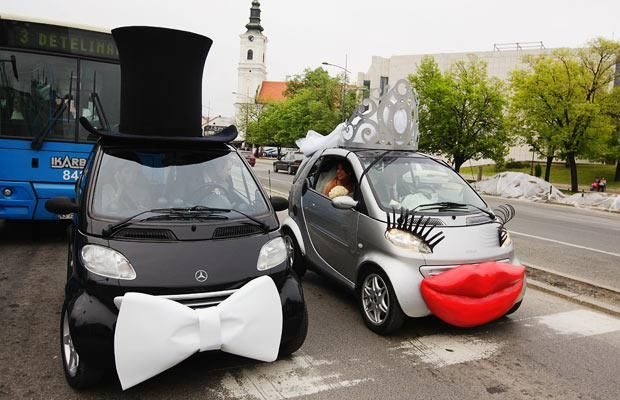 A Bride And Groom In Decorated Smart Cars Go To Their Wedding Ceremony Novi Sad